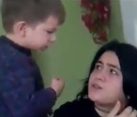 A young boy beats and spits on his mother in shocking video.
