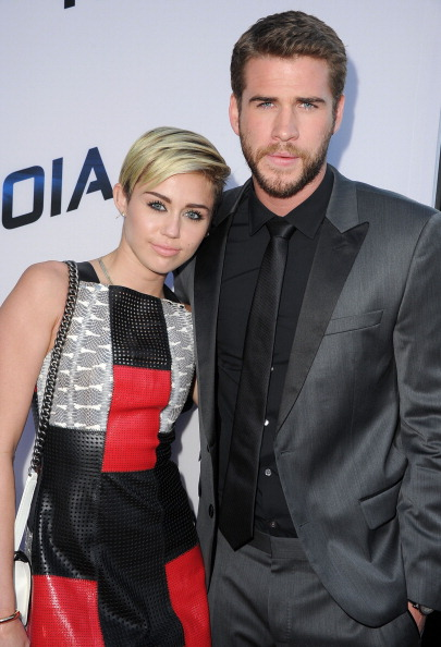 Miley Cyrus Liam Hemsworth arrives at the 'Paranoia' - Los Angeles Premiere at DGA Theater on August 8, 2013 in Los Angeles, California.