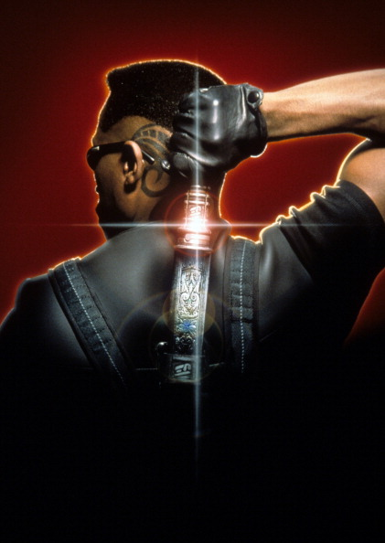 Wesley Snipes holding a dagger behind his back in a scene from the film 'Blade', 1999.