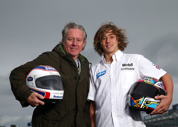 Former 500cc World Champion Wayne Gardner poses with his son Remy ahead of the 2014 MotoGP of Australia at Phillip Island Grand Prix Circuit on October 16, 2014 in Phillip Island, Australia.