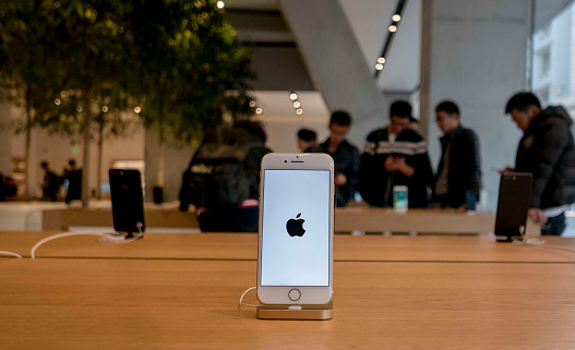 An iPhone 7 is exhibited in an Apple Store