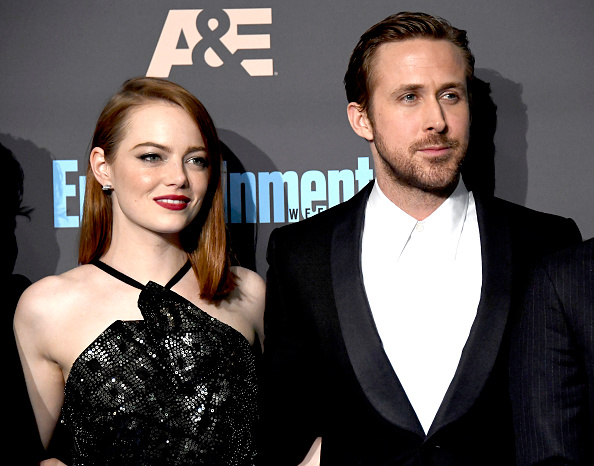 Actress Emma Stone (L) and actor Ryan Gosling pose in the press room during The 22nd Annual Critics' Choice Awards at Barker Hangar on December 11, 2016 in Santa Monica, California.