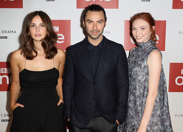 Actor Aidan Turner, actress Heida Reed and actress Eleanor Tomlinson pose for a portrait at the Poldark Series 2 Preview Screening at the BFI on August 22, 2016 in London, England.