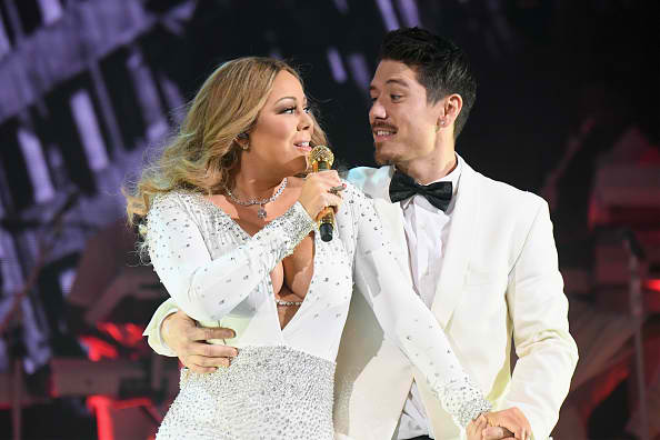 Watch Mariah Carey and her son sing her Christmas carol