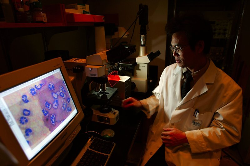 Dr. Jing Kang, from the Department of Medicine, Massachusetts General Hospital & Harvard Medical School sits in his lab March 29, 2006 in Boston, Massachusetts.