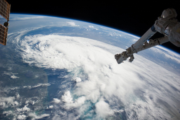 In this handout provided by NASA from the the Earth-orbiting International Space Station, weather system Arthur travels up the east coast of the United States in the Atlantic Ocean near Florida on Jul