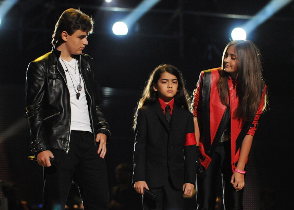 Michael Jackson's children (L-R) Prince Jackson, Blanket Jackson and Paris Jackson speak on stage during the 'Michael Forever Tribute Concert' at Millennium Stadium on October 8, 2011 in Cardiff,Wales