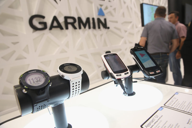 GPS devices designed for golfers lie on display at the Garmin stand at the 2014 IFA home electronics and appliances trade fair on September 5, 2014 in Berlin, Germany.