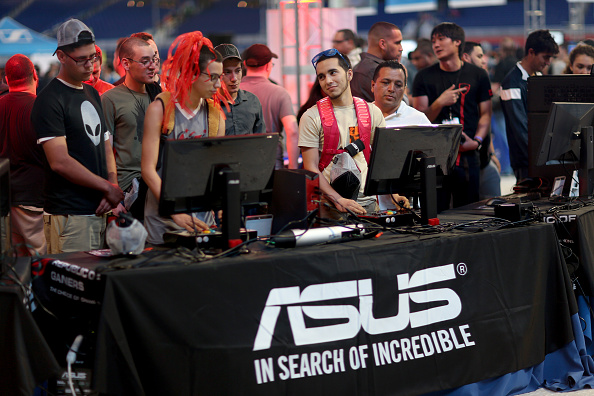 Eduardo Solorzano and George Ascencio play Ultra Street Fighter 4 against each other at the Asus computer booth during the Tiger Direct Tech Bash