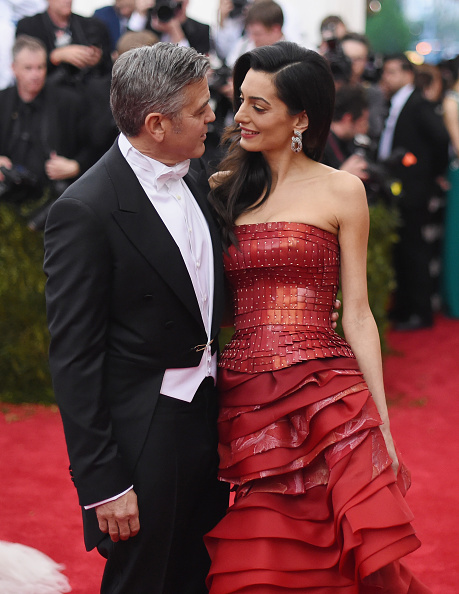 George Clooney (L) and Amal Clooney attend the 'China: Through The Looking Glass' Costume Institute Benefit Gala at the Metropolitan Museum of Art on May 4, 2015 in New York City.