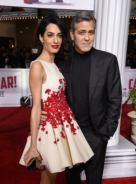 Actor George Clooney (R) and Amal Clooney attend Universal Pictures' 'Hail, Caesar!' premiere at Regency Village Theatre on February 1, 2016 in Westwood, California.