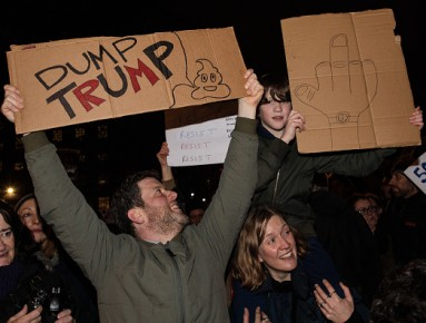 LONDON, ENGLAND - JANUARY 30: Demonstrators holding placards attend a protest outside Downing Street against U.S. President Donald Trump's ban on travel from seven Muslim countries on January 30, 2017 in London, England. President Trump signed an executiv