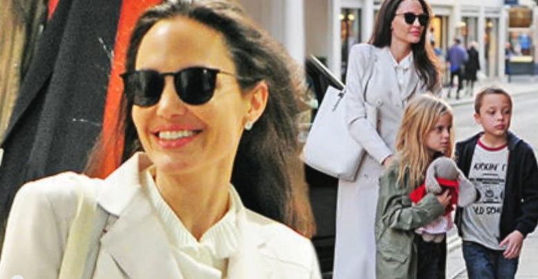 Angelina Jolie Spotted On A Literary Shopping Spree In London Amid     Latin Post Angelina Jolie beams as she stuns in an all white ensemble while enjoying a day out