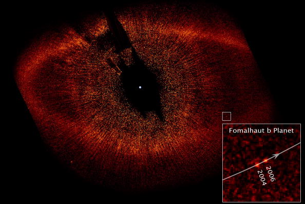 UNDATED: In this handout provided by NASA, a visible-light image from the Hubble Space Telescope shows a red ring of dust and debris that surrounds the star Fomalhaut and the newly discovered planet, Fomalhaut b, orbiting its parent star