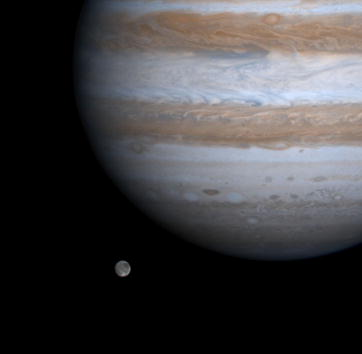 The solar system's largest moon, Ganymede, is captured here alongside the planet Jupiter in this picture taken by NASA's Cassini spacecraft, December 3, 2000.