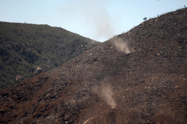 MAY 16: Dust devils lift ash and dirt from a burned hillside at the Cocos fire on May 16, 2014 in San Marcos, California. The fire continues to threaten communities with little containment three days after nine wildfires broke out in a single day in San D