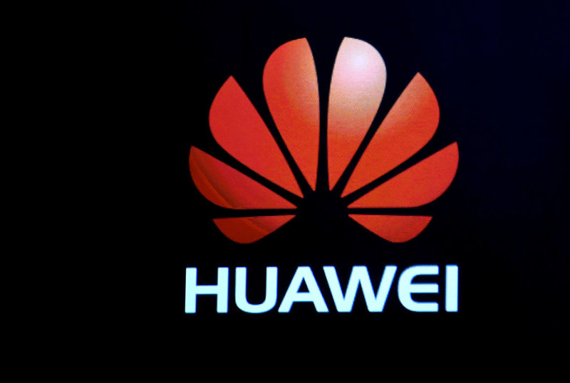 A Huawei logo is shown on a screen during a keynote address by CEO of Huawei Consumer Business Group Richard Yu at CES 2017.