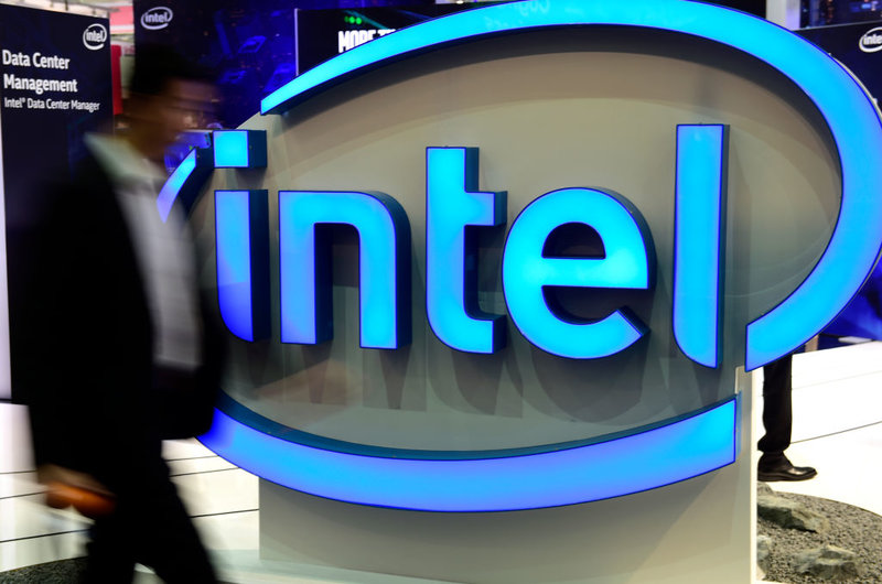 A visitor walks by the Intel stand at the CeBIT 2017 Technology Trade Fair on March 20, 2017 in Hanover, Germany.