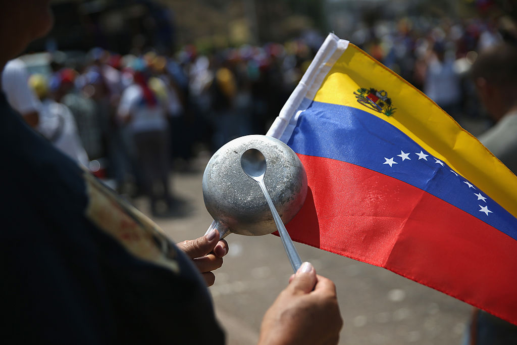 2 dead as Venezuela protests turn violent outside capital