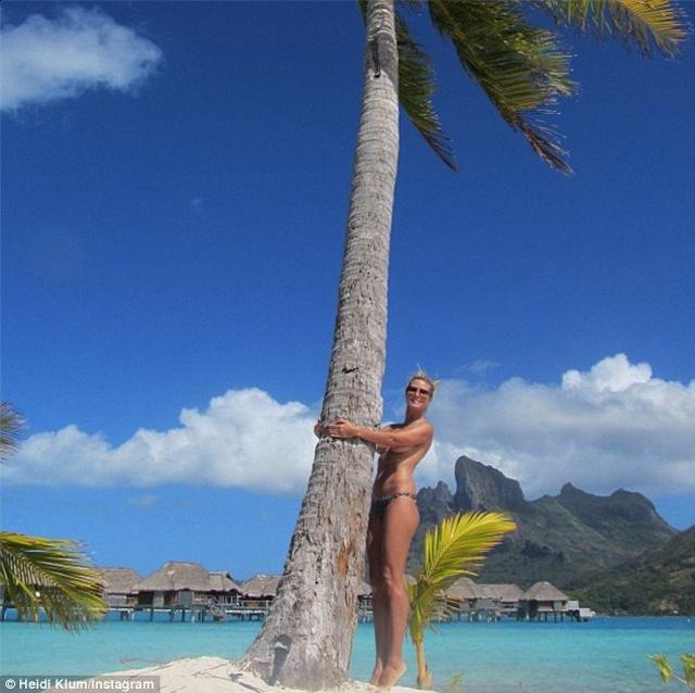 Heidi Klum topless on the beach in Bora Bora