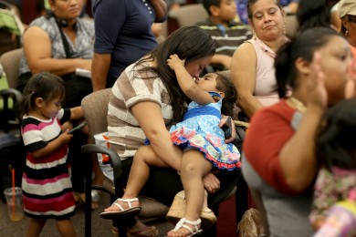 Wendy Nunez, originally from Honduras, holds her daughter, Gianella Hernandez, as she attends an Immigration Field Hearing held by U.S. Rep Joe Garcia (D-FL) and Rep. Ted Deutch (D-FL) at Broward College on August 13, 2014 in Fort Lauderdale, Florida.