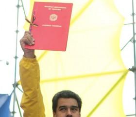 President Nicolas Maduro Holds Up Law Granting Him New Power