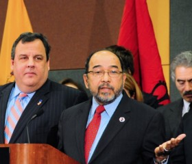 Martin Perez, shown here with NJ Governor Chris Christie at his appointment to the Board of Governors of Rutgers, has stood up for Christie in the ongoing conflict over the New Jersey Dream Act