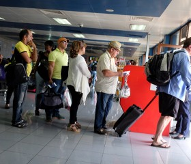 Cubans Await to Board a Plane to Miami