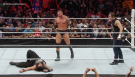 "Randy Orton standing tall after delivering an RKO on Roman Reigns on ""Monday Night Raw"" while Dean Ambrose stands in disbelief."