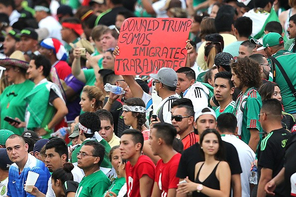A Mexican fan holds up a Donald Trump sign during an international friendly soccer match between Mexico and Costa Rica at the Orlando Citrus Bowl on June 27, 2015 in Orlando, Florida. The game ended in a 2-2 draw.