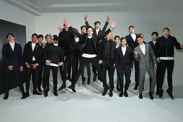 Fashion designer Carlos Garciavelez (C) poses with models at Garciavelez presentation during Mercedes-Benz Fashion Week Fall 2015 at Industria Studios on February 11, 2015 in New York City.