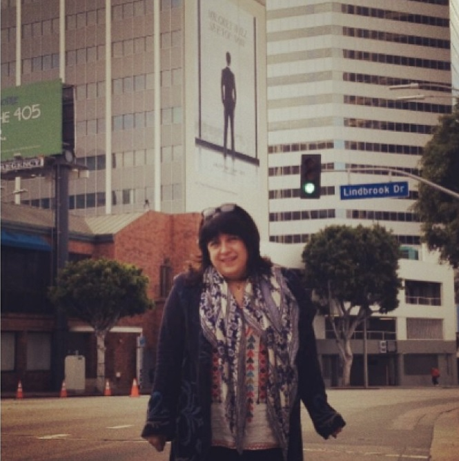 Author E.L. James posting under the Fifty Shades Poster