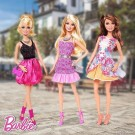 Mattel's Barbie sporting her different outfits