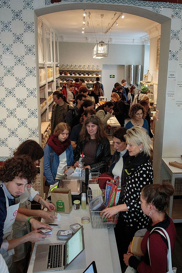 Women Shoppers Waiting in a Line at the Cashier