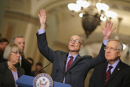 Sen. Charles Schumer (D-NY) (C) answers reporters' questions duirng a news conference with (L-R) Sen. Patty Murray (D-WA), Senate Minority Whip Richard Durbin (D-IL) and Senate Minority Leader Harry Reid (D-NV) senate