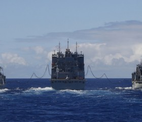 USNS Cesar Chavez replenishes Royal Australian Navy ships.