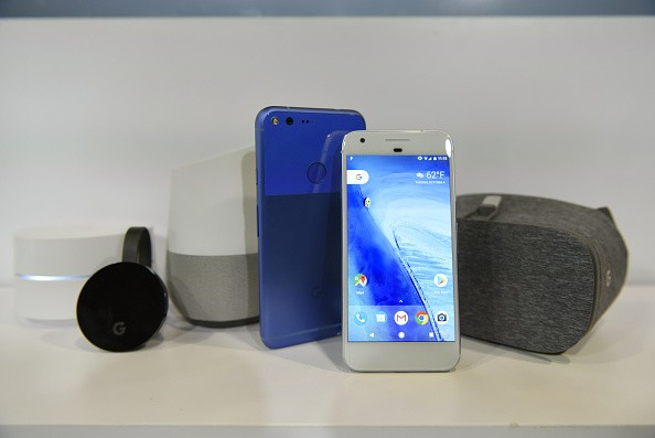 The Google Wifi router, from left, Chromecast Ultra, Home, Pixel XL, Pixel, and Daydream View devices sit on display during a product launch event in San Francisco, California, U.S., Oct. 4, 2016.
