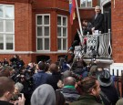 Wikileaks founder Julian Assange speaks from the balcony of the Ecuadorian embassy where he continues to seek asylum following an extradition request from Sweden in 2012, on February 5, 2016 in London