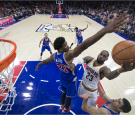LeBron James of the Cleveland Cavaliers goes up for a shot against Joel Embiid of the Philadelphia 76ers in the fourth quarter at Wells Fargo Center on November 5, 2016 in Philadelphia, Pennsylvania.