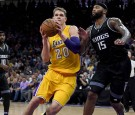 Timofey Mozgov #20 of the Los Angeles Lakers drives to the basket on DeMarcus Cousins #15 of the Sacramento Kings during an NBA basketball game at Golden 1 Center on November 10, 2016 in Sacramento,CA