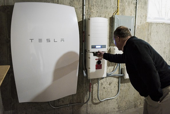 A customer inspects a Tesla Motors Inc. Powerwall unit inside a home in Monkton, Vermont, U.S., on Monday, May 2, 2016