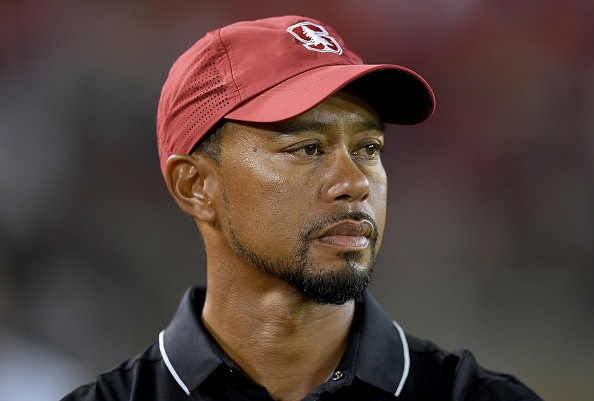 PALO ALTO, CA - OCTOBER 08: Golfer Tiger Woods looks on from the sidelines during an NCAA football game between the Washington State Cougars and Stanford Cardinal at Stanford Stadium on October 8, 2016 in Palo Alto, California.