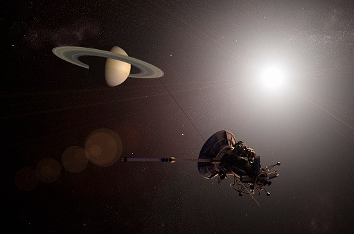 Illustration of Unmanned spacecraft approaching the planet Saturn