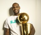 Portrait of Miami Heat LeBron James casual, posing with Larry O'Brien Championship Trophy during photo shoot at Four Seasons Hotel. Miami, FL.