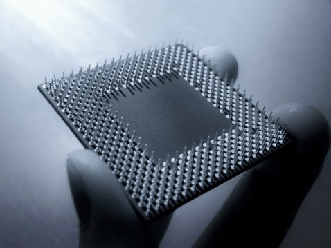 CPU Processor chip held in fingers