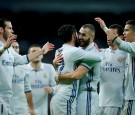 Karim Benzema of Real Madrid CF celebrates scoring their opening goal with teammates during the La Liga match between Real Madrid CF and Athletic Club de Bilbao at Estadio Santiago Bernabeu