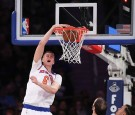 Kristaps Porzingis #6 of the New York Knicks slams home a dunk against the Sacramento Kings during the first half at Madison Square Garden on December 4, 2016 in New York City.