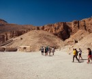A small group of tourists walk toward the entrance to a tomb in The Valley of the Kings on October 23, 2013 in Luxor, Egypt.