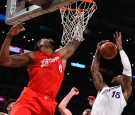 DeAndre Jordan #6 of the Los Angeles Clippers and Thomas Robinson #15 of the Los Angeles Lakers battle for a rebound in the first half of the game at Staples Center on December 25, 2016 in Los Angeles, California.