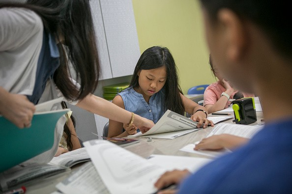 Lee Tae-rim, 10 (C), takes an English-language test at paedeaplus English school on August 10, 2016 in Seoul, South Korea. Lee, a class president who also excels in academics.